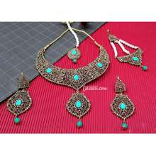 TUSSAAR Grand Gold Turquoise AD CZ Choker Necklaces Set with Maang Tika and Jhoomer